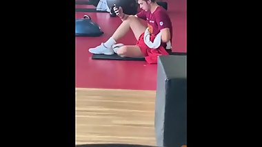 Young man masturbating at the gym