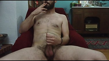 Brunette Bearded Guy Jerks Off His Self While He Is Smoking A Cigarette
