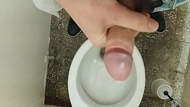 Jerking off in a public toilet