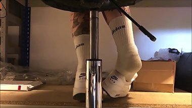 skater girl shoeplay at work in smelly socks